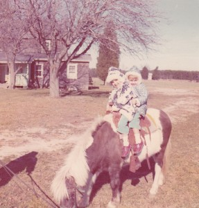 My sister and I riding Cindy, our pony.